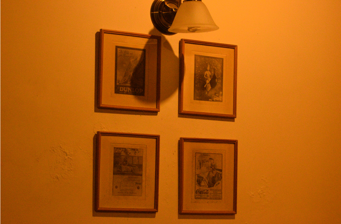 Vintage brand collection on the walls of cottage